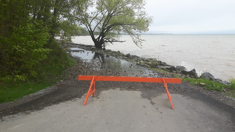 picture of barricade at Charles Daley Park closing part of park due to water levels