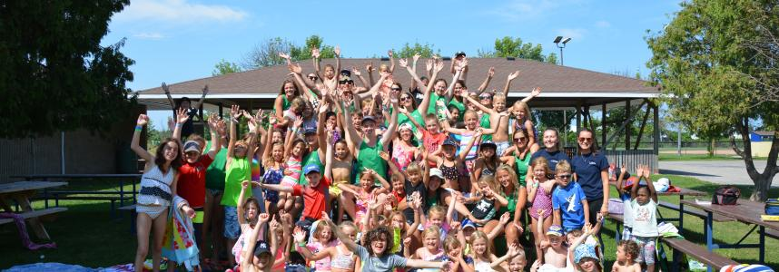 Kids cheering at summer camp in Lincoln