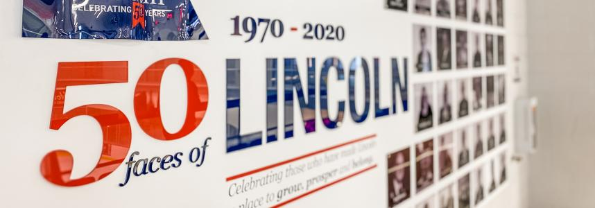 Image of the 50 faces of Lincoln mural at Fleming Centre