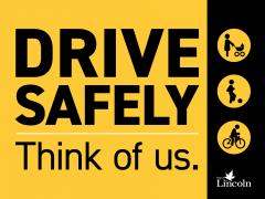 "Image of neighbourhood safety sign that reads ""Drive Safely, think of us"""